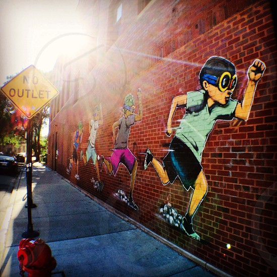 Running. Street art by Ebru Brantley. Chicago.  photo