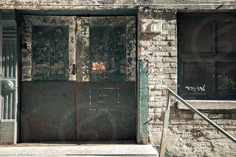 black door and brown brick wall photo