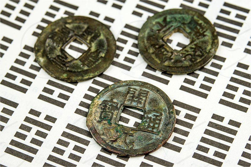I Ging chinese divination with antique coins photo