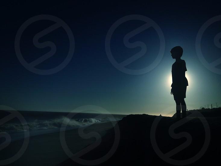 boy standing silhouette  photo