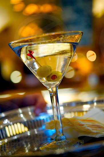 alcohol; alcoholic; background; bar; berry; beverage; black; classic; closeup; cocktail; cold; color; cook; cool; crystal; cup; drink; energy; eve; falling; food; fresh; fruit; glass; green; healthy; hot; ice; isolated; juice; light; liquid; liquor; man; martini; new; nutrition; olive; party; reflection; refreshment; restaurant; slice; sweet; traditional; vitamin; vodka; water; woman; yellow photo