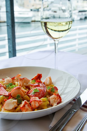 Seafood pasta and white wine photo