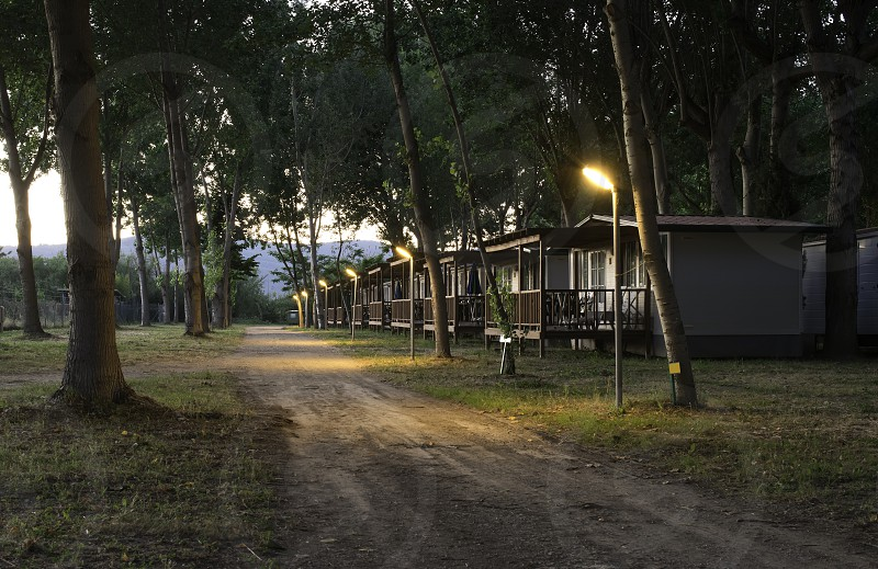 Wooden bungalow in camping at night photo
