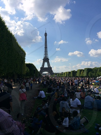 Waiting for fireworks on the Champ des Mars - Paris France. July 14 2014 photo