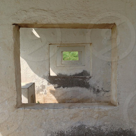 square holes on white cement walls photo