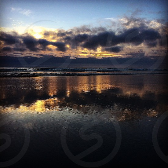 Reflection of the ocean at sunset photo