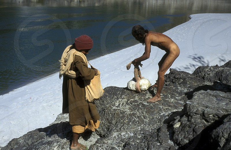 two men on the Ganges River in the town of Rishikesh in the Province Uttar Pradesh in India. photo