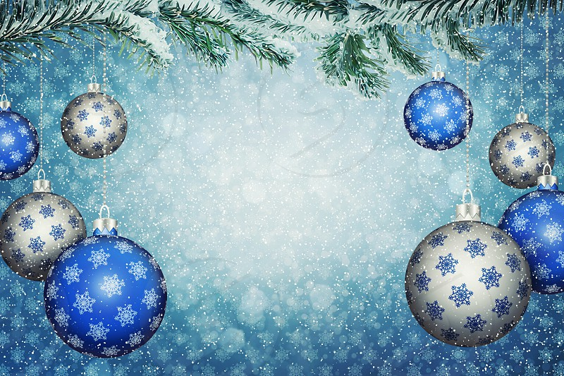 Set of blue and silver balls with snowflake pattern hang on a snowy fir branch. Christmas and New Year background with copy space. 3D illustration. photo