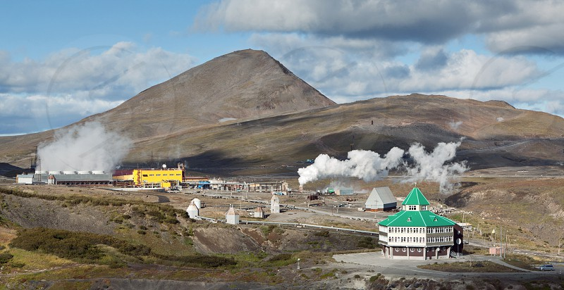 MUTNOVSKY VOLCANO KAMCHATKA RUSSIA - SEP 21 2011: General view of the Mutnovskaya Geothermal Power Station and the building of the hotel. Eurasia Russian Far East Kamchatka Peninsula. photo