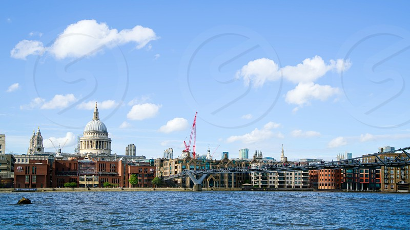 LONDON - JULY 27 : Buildings on the North Bank of the River Thames in London on July 27 2017 photo