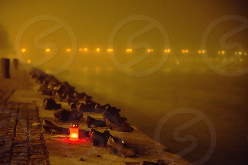 Shoes on the Danube Bank candles at the memorial Budapest Hungary photo