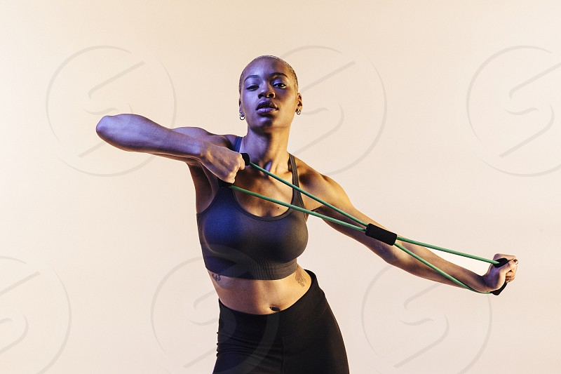 Woman stretching resistance band photo