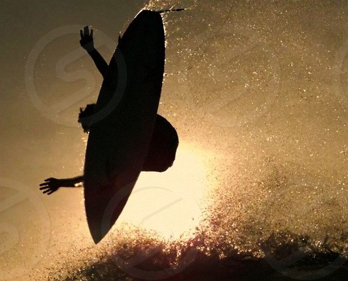 surfing surf jump sky ocean surf splashunder the surfboard fun sunsurfboardup in the sky photo