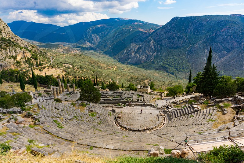 View of the ancient theater and temple of Apollo in Delphi Greece photo