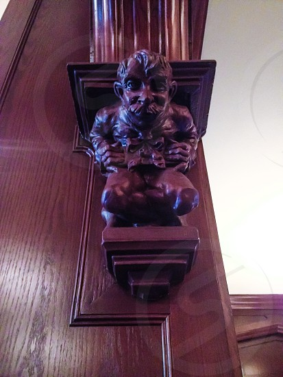 brown wooden wood carving photo