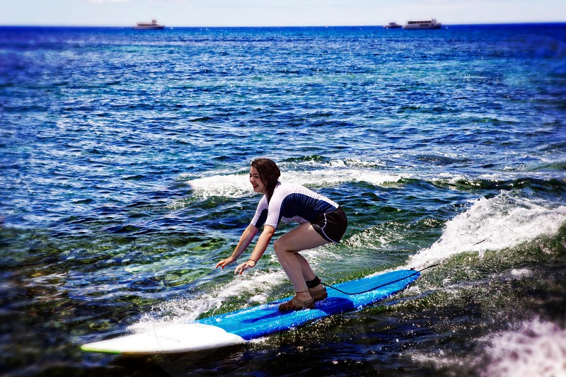 woman surfing photography photo