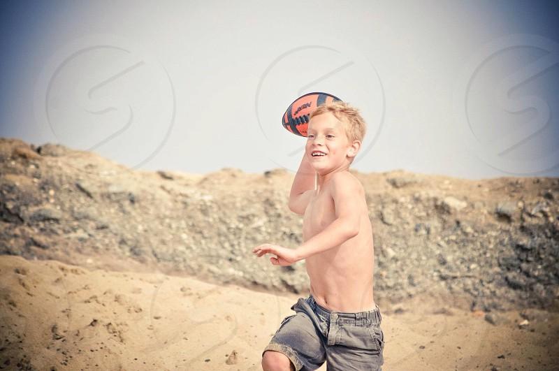 Boy - football - beach photo