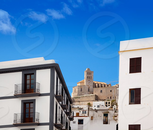 Eivissa Ibiza town with church under summer blue sky photo
