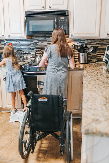 Woman who had a stroke is cooking photo