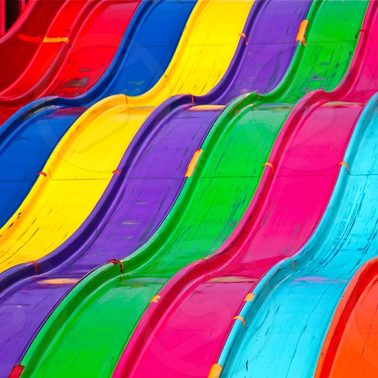 orange teal pink green purple yellow and blue water slides photo