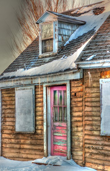 Old abandoned house with Pink door photo