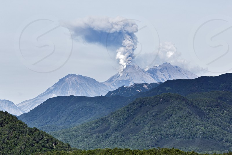 Beautiful mountain (volcanic) landscape of Kamchatka Peninsula: eruption active Zhupanovsky Volcano on Kamchatka (Russia Far East). photo
