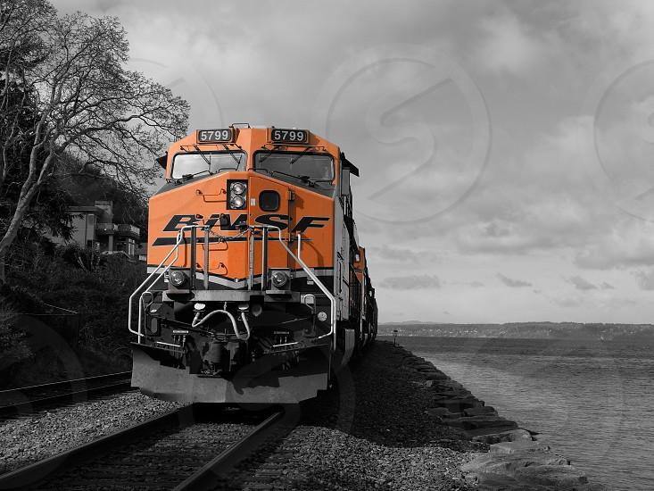Train locomotive black and white water orange clean spring photo