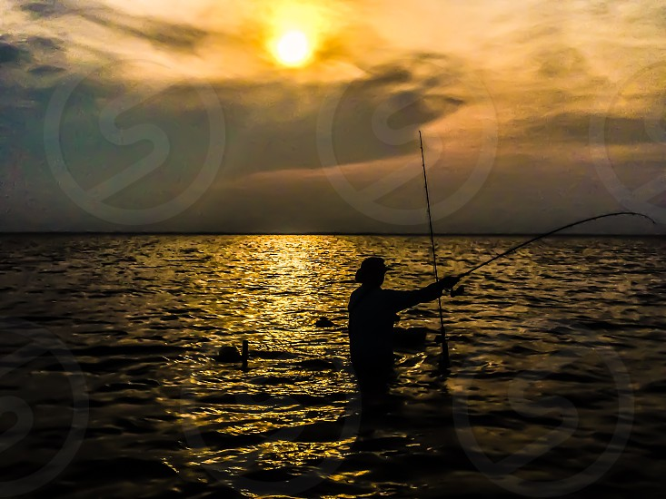 The catch Keywords: tranquil sunset south Texas tranquility beauty relaxing fishing water ocean fish fishing pole outdoors nature wading relax skyline clouds end of day vacation photo