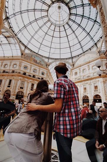 couple taking photo under dome of venetian casino photo