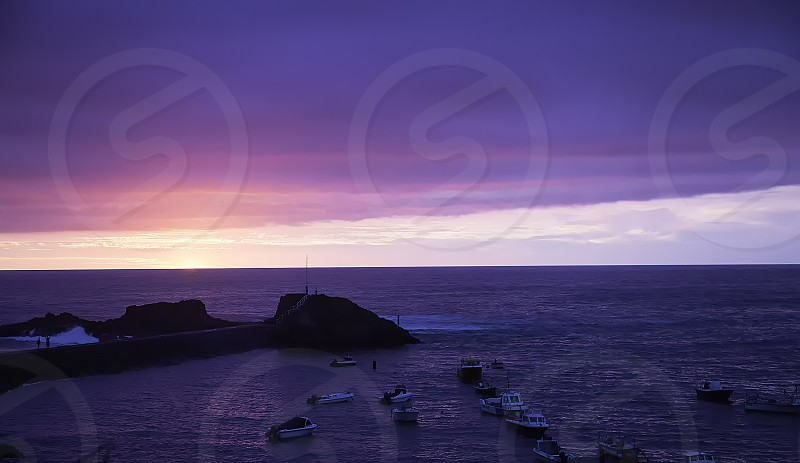 sunset as it just ends looking back over the harbour of bude in southwest england cornwall photo