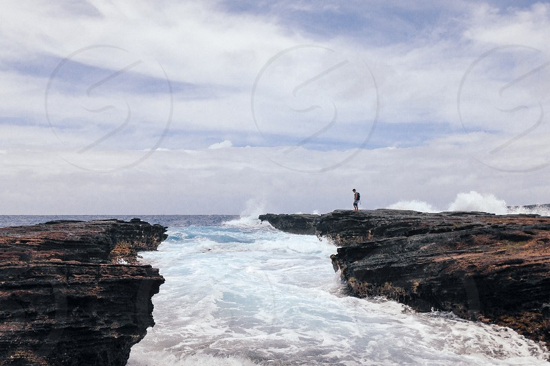 man standing on a rock photo