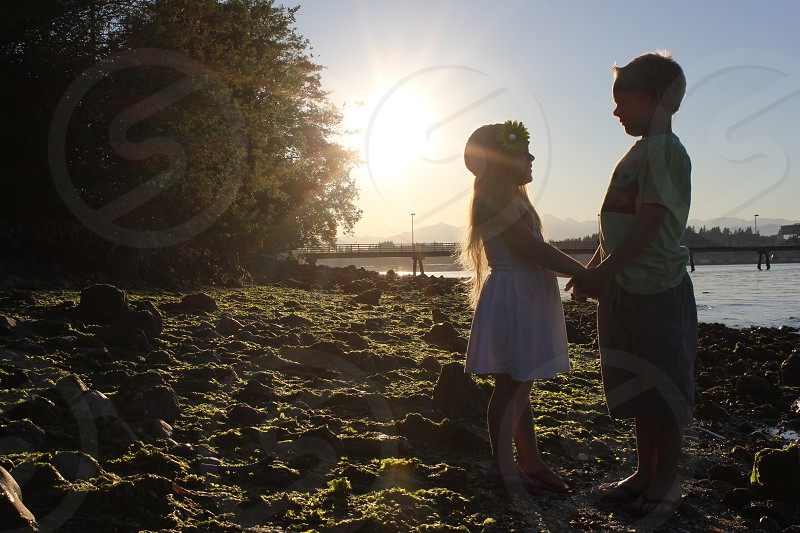 Sunset photo shoot with loving siblings  photo