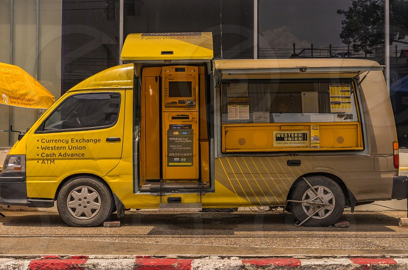 A mobile ATM in a yellow van. photo