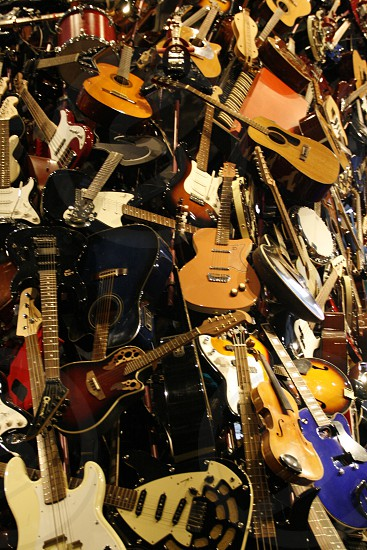 Cluster of guitars.  photo