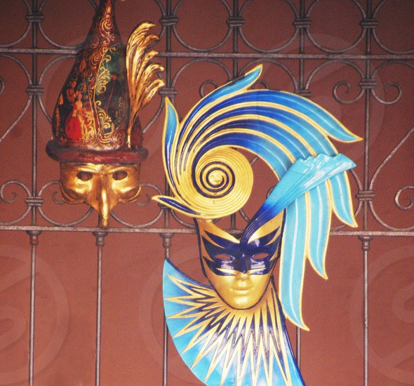 yellow and blue mask on the metal fence photo