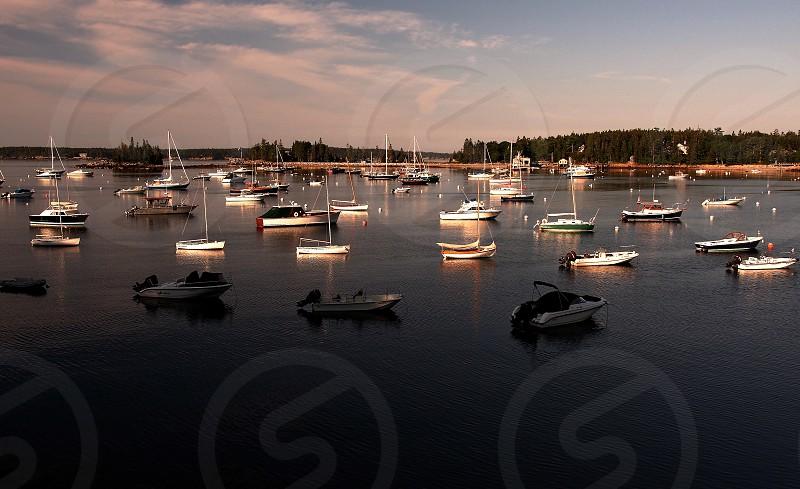 Fishing boats in bay at sunrise. photo