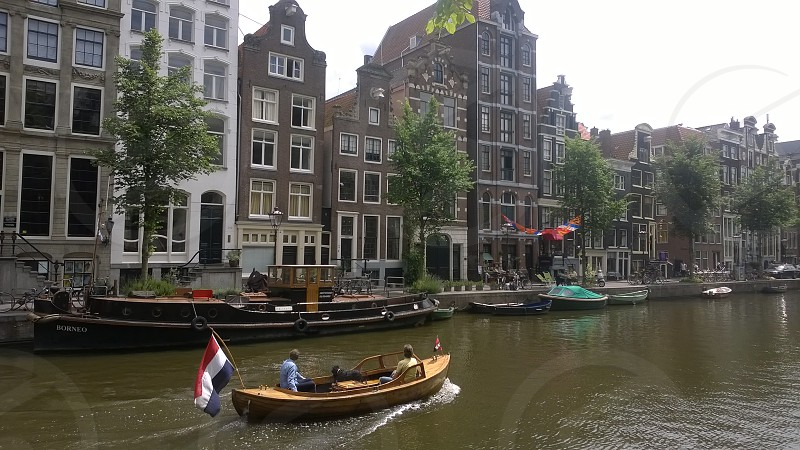 Canal Bridge River Sky Clouds Trees Cars Boat Amsterdam Netherlands photo