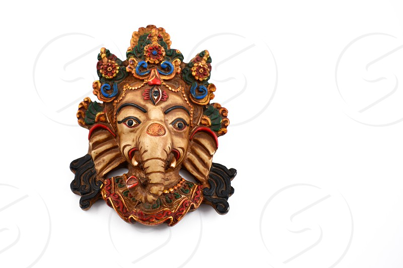 Ganesha head. Ganesha on a white background. Ganesha statuette isolated on white background. Elephant head photo