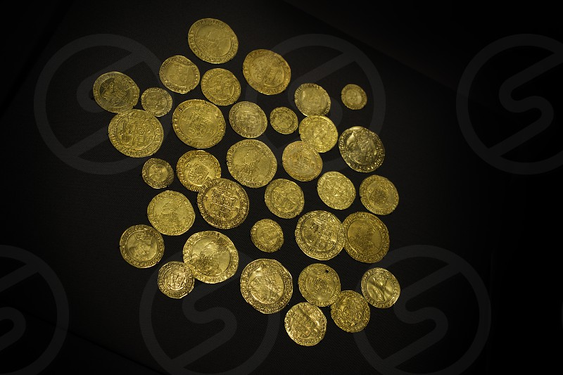Ancient and precious priceless gold coins. photo