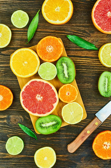 Slice fruits. Oranges limes grapefruits tangerines pear kiwi and lemons photo