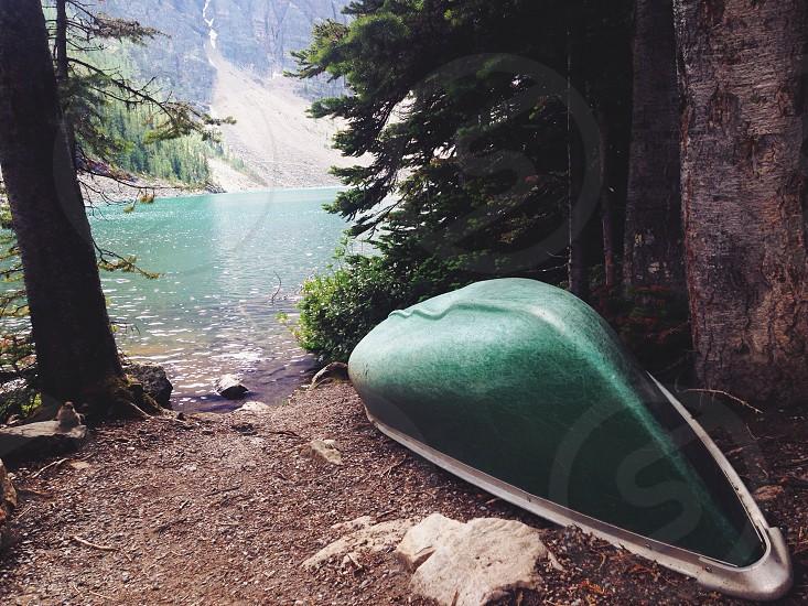 Canoe at mountain Lake Agnes in Alberta Canada Banff National Park photo