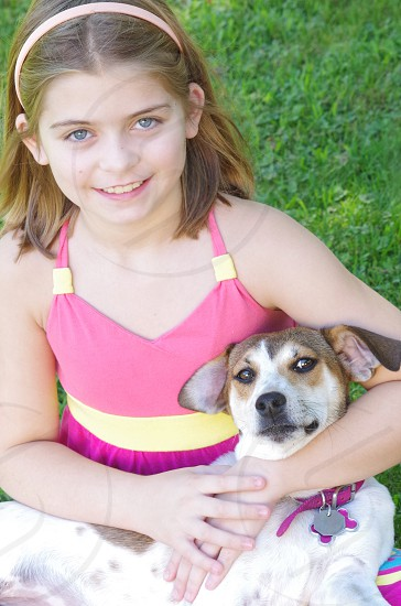 Girl with beautiful rescue dog photo