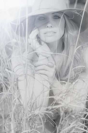 woman in hat and white long sleeve shirt in grayscale photo