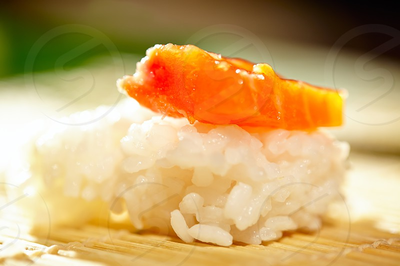 Rice with salmon. Macro shot with beautiful shallow dof illustrating making sushi process. photo