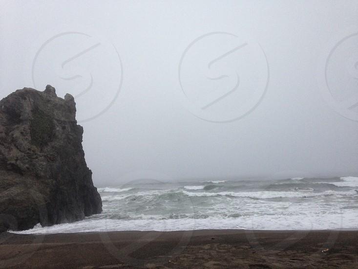rock formation near ocean photo