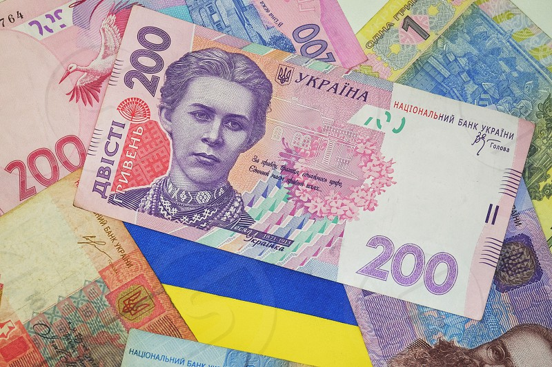 Ukrainian flag and currency. photo