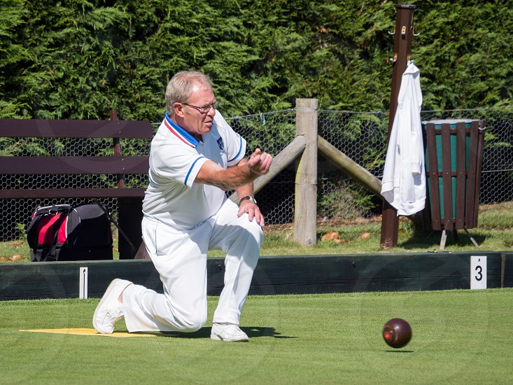 ISLE OF THORNS SUSSEX/UK - SEPTEMBER 11 : Lawn Bowls Match at Isle of Thorns Chelwood Gate in Sussex on September 11 2016. Unidentified man photo