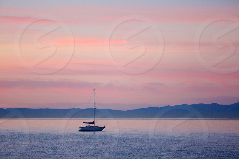 lake sunset with boat photo