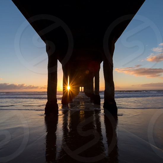 Under Pier Pressure with a ray of sunshine photo