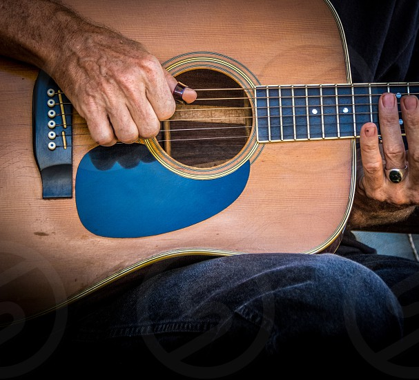 musician playing acoustic guitar photo